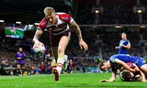 Wigan Warriors' Dominic Manfredi scores his team's first try.