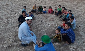 Esmail Azarinejad reads to children in Iran