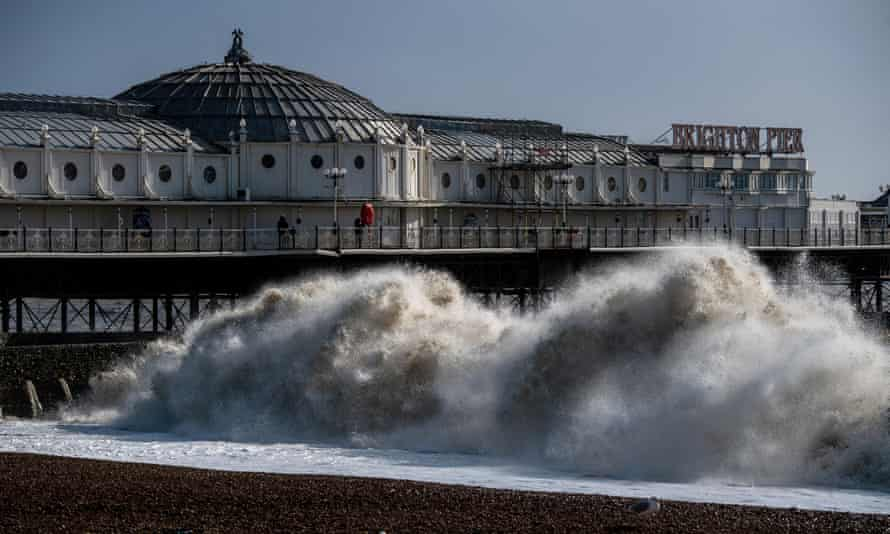 Waves crash on the beach next to Brighton pier as high winds continue following Storm Ciara