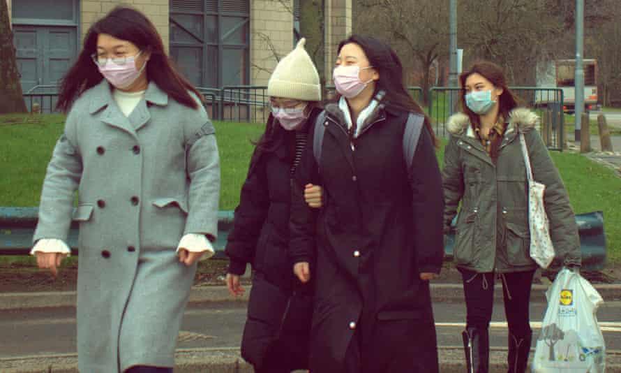 Anxious students in Glasgow taking precautions prior to the coronavirus lockdown.