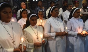 Pakistani Christians and Muslims hold candles at a tribute to Sri Lankan bomb blast victims at the Sacred Heart Cathedral Church in Lahore, Pakistan