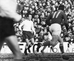 Jimmy Greaves surges forward against his former club Chelsea in their match at White Hart Lane in February 1964.