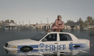 Beyoncé sits atop a New Orleans police car, in the opening of her video for Formation.