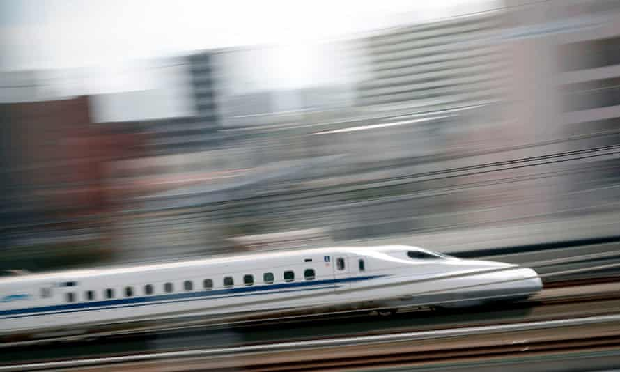 A bullet train streaks through the station of Hamamatsu