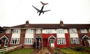 Plane flying over houses near Heathrow