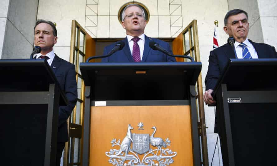 Australia's health minister Greg Hunt, prime minister Scott Morrison and chief medical officer Brendan Murphy speak to the media in Canberra
