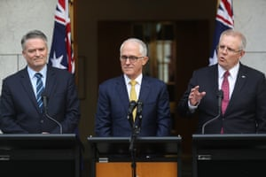 A somewhat less glum Turnbull flanked by Mathias Cormann and Scott Morrison.
