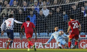 Millwall's Jordan Archer makes a save from Leicester City's Shinji Okazaki