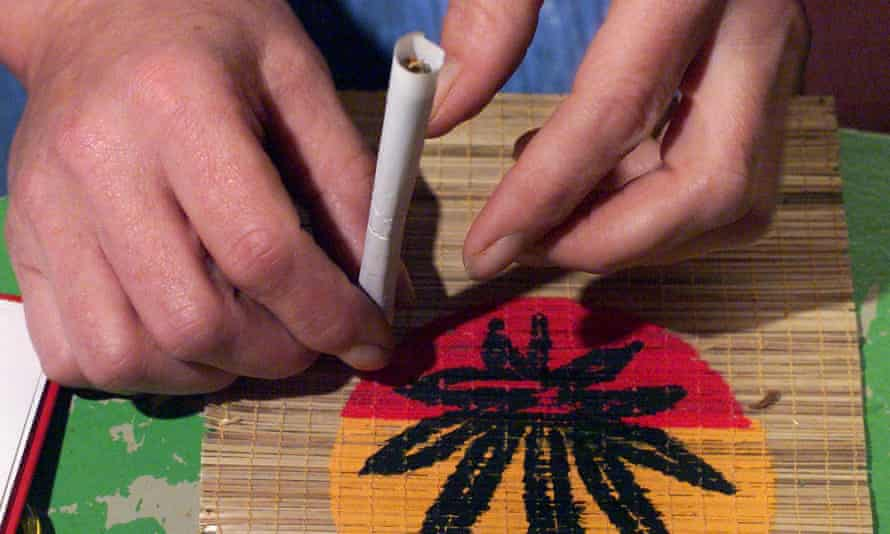 a person rolls a joint