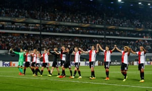 Feyenoord players celebrate after the game.