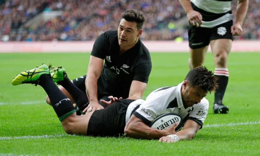 Richie Mo'unga goes over for the Barbarians early in the match.
