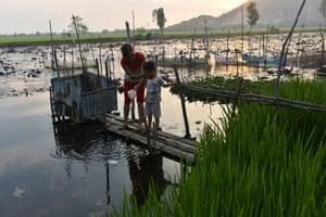 Phham Thi Lan, 31, and her son, Vinh, four, at Vinh Xuyen village, Tinh Bien district, Vietnam