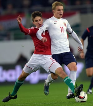 Norway's 16-year-old midfielder Martin Odegaard, right, looks older than Hungary's Adam Nagy.