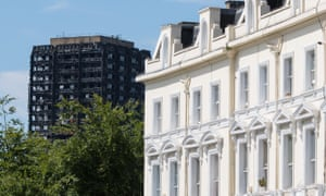 Grenfell Tower is seen alongside terraced houses in Notting Hill, west London