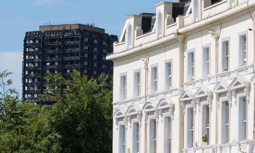 Grenfell Tower in London, seen beyond a terrace of expensive properties
