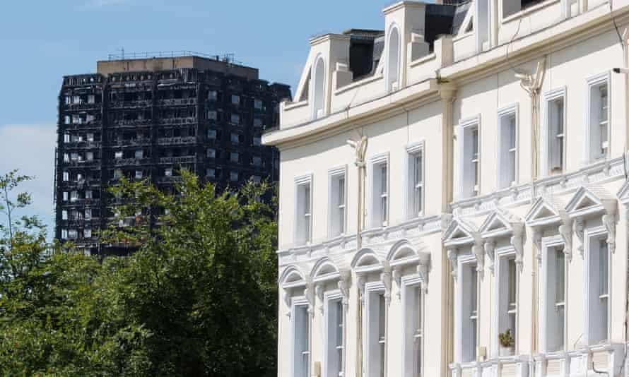 Grenfell Tower is seen alongside terraced houses in west London