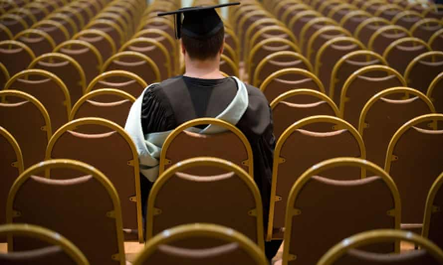 A university graduate waits for his ceremony to begin.