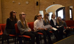 Schoolchildren interact with 3D images of Holocaust survivors.