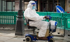Person on mobility scooter wearing PPE