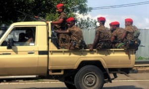 Ethiopian military ride on their pick-up truck as they patrol the streets following protests in Addis Ababa.