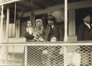 Italian family on the ferry boat landing at Ellis Island, 1905 Hine photographed immigrants at Ellis Island from 1904 to 1909, taking some 200 photographs in all. The work has drawn comparisons to that of Jacob Riis, the Danish-American social photographer and journalist who chronicled the lives of impoverished people on New York City's Lower East Side.