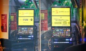 Gambling slot machines seen from outside a betting shop in Coatbridge