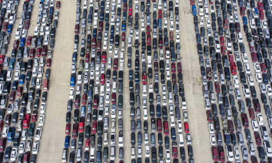 People wait in their cars at Traders Village for the San Antonio food bank in Texas on 9 April.
