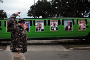A limousine decorated with pictures of Donald Trump