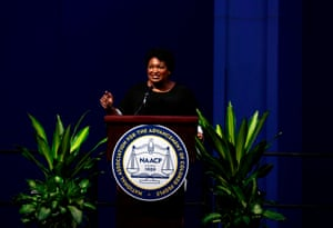 Stacey Abrams speaks during the NAACP's national convention in Detroit, Michigan.