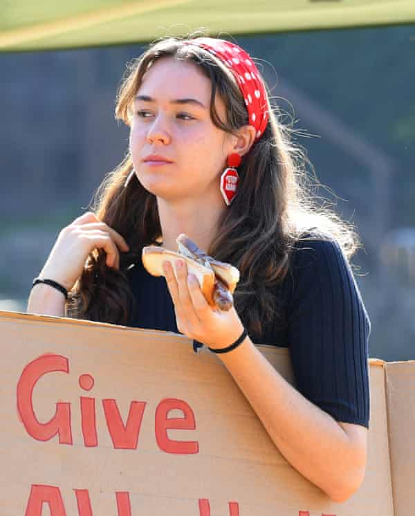 School striker Vivienne Paduch, 15, wearing Stop Adani earrings at Queenscliff Surf Life Saving Club on election day in Sydney