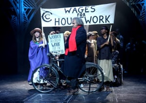 Scrooge (Ashley Driver) runs into an equal pay march in A Christmas Carol at the Chickenshed.