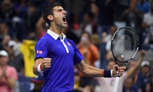 Novak Djokovic reacts after winning a game against Roger Federer during the 2015 US Open men's singles final.
