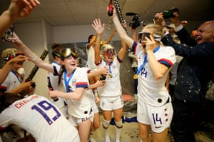 The USA Women's football team celebrate in ski masks after winning the World Cup