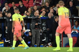 Pep Guardiola instructs his players during Manchester City's win against Crystal Palace.