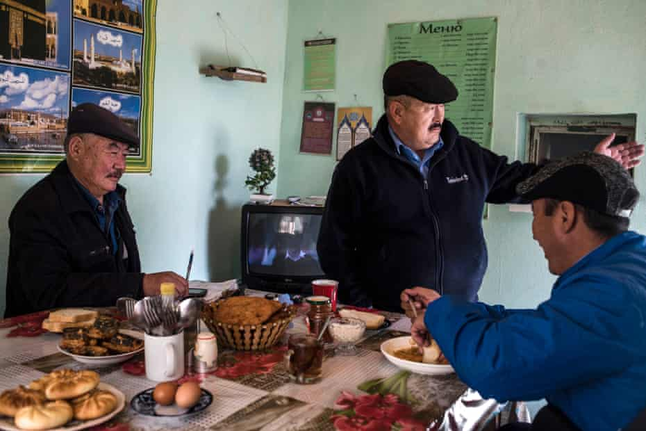 Bus drivers and their dispatcher, far left, in the Ak-Zhar cafe that doubles as their public transport office