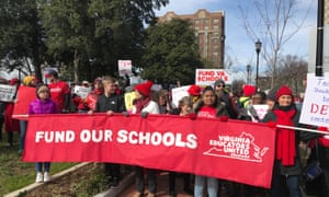 An estimated 10,000 teachers and their supporters packed the streets of Richmond, Virginia on Monday to protest for higher pay and more funding.