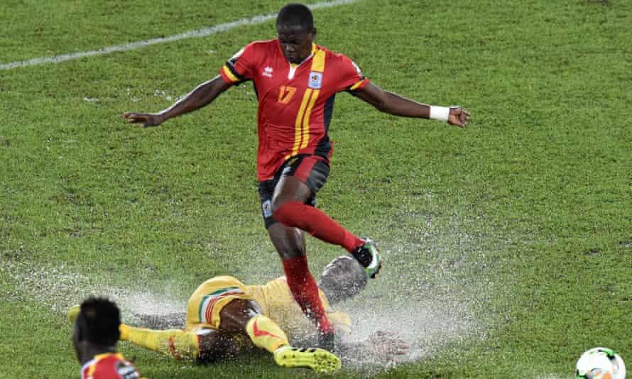 Uganda's Farouk Miya jumps over Mali's Mahamadou N'Diaye
