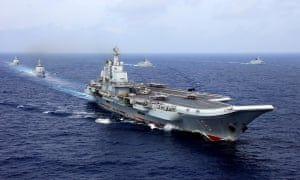 Chinese aircraft carrier takes part in a military drill. China is said to be 'on the verge of fielding some of the most modern weapon systems in the world'.