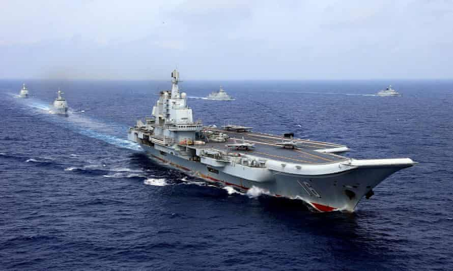 China's aircraft carrier Liaoning takes part in a military drill of Chinese People's Liberation Army (PLA) Navy in the western Pacific Ocean in 2018.