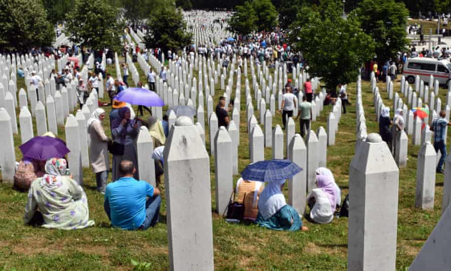 Bosnian Muslim women, family members of victims of Srebrenica 1995 massacre, gather prior to the burial of their relatives at the memorial cemetery in village of Potocari, near Eastern-Bosnian town of Srebrenica.
