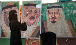 Paintings showing Saudi King Salman, right, and Crown Prince Mohammed bin Nayef in Jeddah