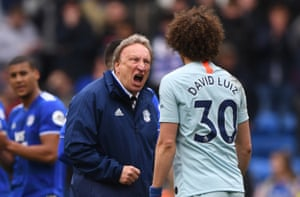 March 31: Cardiff manager Neil Warnock has words with Chelsea player David Luiz.
