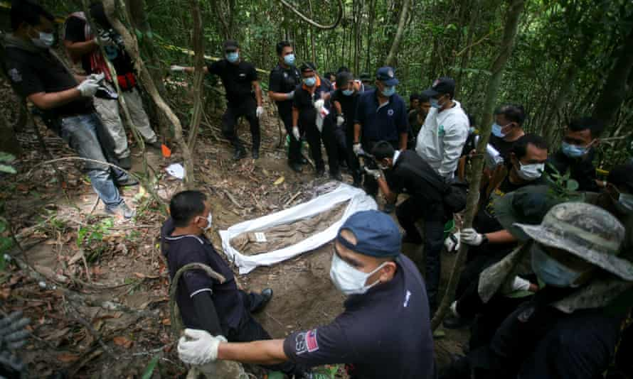 A Malaysia forensic team at a mass grave site discovered on the border with Thailand in May.
