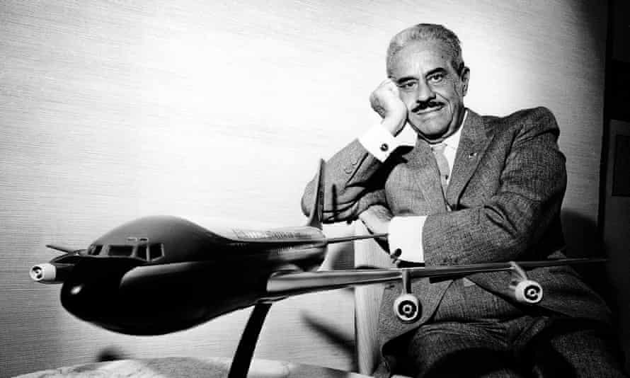The master … Raymond Loewy poses in his office with a model of the presidential plane.