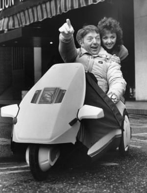 Paul Daniels and Debbie McGee test Sir Clive Sinclair's new Cg battery powered car, 1985