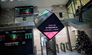 Share price information is displayed on screens at the London Stock Exchange offices after reopening following the Christmas holiday.
