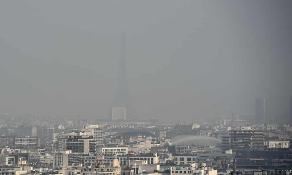 A haze of pollution obscures the Eiffel tower in Paris