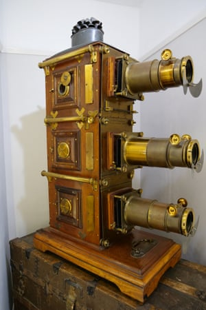 An 1890s tri-unial (three lens) lantern by W Watson & Sons, on its original travelling trunk. The rare item is still in use at the museum.