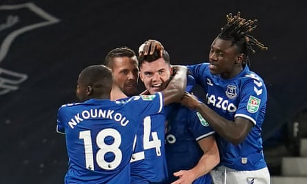 Moise Kean, scorer of Everton's third from the spot, joins teammates in congratulating Michael Keane on the first goal against Salford in their Carabao Cup tie