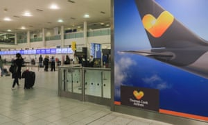 Passengers approach the Thomas Cook check-in desk at Gatwick airport in London.